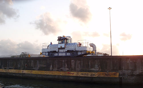 "These rail engines, called ""mules,"" run along both sides of the Panama Canal to pull large ships through without requiring them to use their engines."