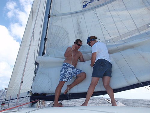 Jason and Karen fix the mainsail