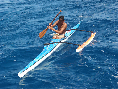 Outrigger races Tahina in the pass