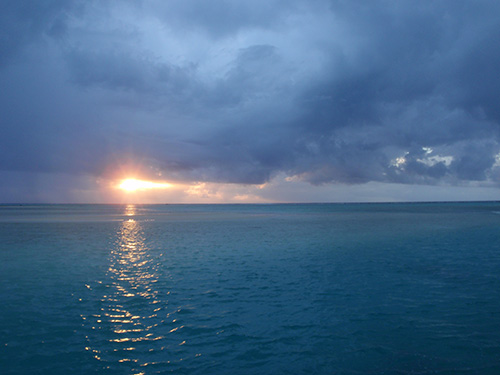 Sunset over Aitutaki's lagoon