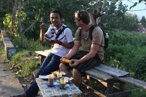 Rycko and Jason eat corn in Sungai Penuh