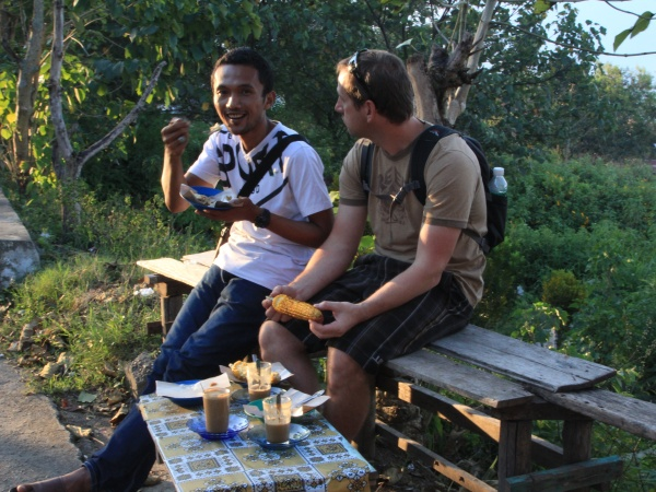 Rycko and Jason eat corn in Sungai Penuh