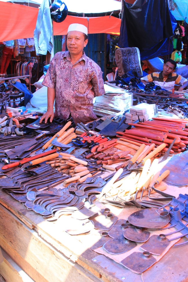Blacksmith at the market in Sungai Penuh